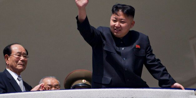 North Korean leader Kim Jong Un waves from a balcony at the end of a mass military parade in Pyongyang's...
