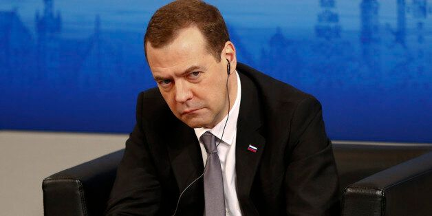 Russian Prime Minister Dmitry Medvedev waits on the podium at the Security Conference in Munich, Germany,...