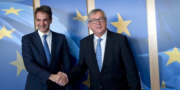 President of New Democracy of Greece Kyriakos Mitsotakis, left, is greeted by European Commission President...