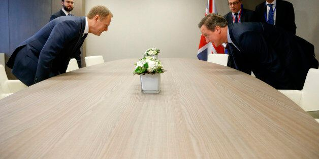 British Prime Minister David Cameron, right, takes his seat with European Council President Donald Tusk,...