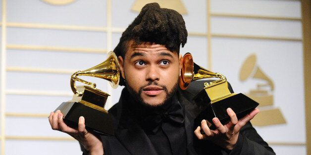 LOS ANGELES, CA - FEBRUARY 15: The Weeknd poses in the press room at the The 58th GRAMMY Awards at Staples...