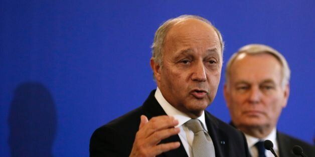 France's outgoing Foreign Minister Laurent Fabius (Front) delivers a speech as newly appointed French...