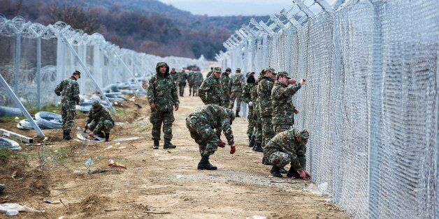 Macedonian soldiers build a second border fence to prevent illegal crossings by migrants at the Greek-Macedonian...