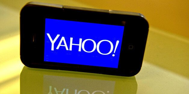 This September 12, 2013 photo illustration shows the newly designed Yahoo logo seen on a smartphone....