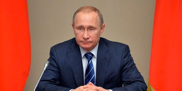 Russian President Vladimir Putin chairs a Security Council meeting in the Novo-Ogaryovo residence outside...