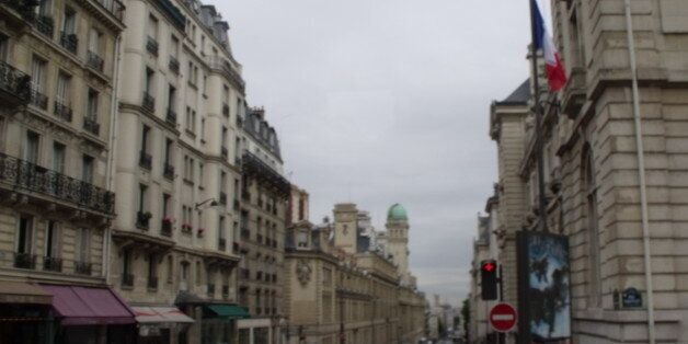 Continuing to have a tour around Paris by coach. Streets with cafes. We were heading from Place Edmond...