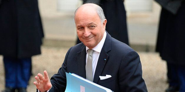 French Foreign Affairs minister Laurent Fabius waves as he arrives before a meeting with the Iranian...