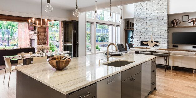 Kitchen with Island, Sink, Cabinets, and Hardwood Floors in New Luxury Home, with View of Living Room,...