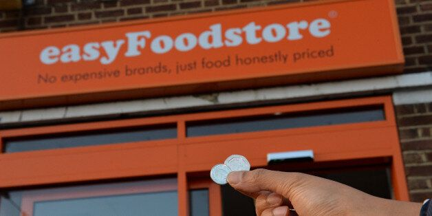 Shoppers buy items for 25p in a new easyFoodstore owned by easyJet founder Sir Stelios Haji-Ioannou in...