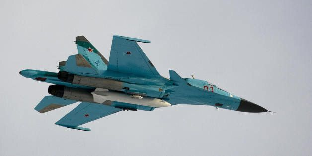 A Su-34 bomber jet with Russian President Dmitry Medvedev aboard flies over the Kubinka airfield near...