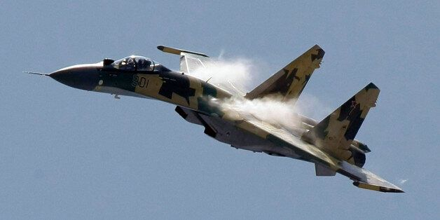 FILE - In this Tuesday, Aug. 18, 2009 file photo, a Russian Sukhoi Su-35 air force jet flies during MAKS-2009...