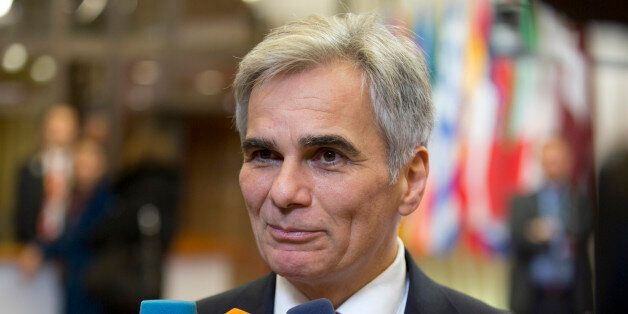 Austrian Chancellor Werner Faymann speaks with the media as he leaves after an EU summit in Brussels...