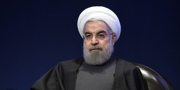 Iranian President Hassan Rouhani looks on during a meeting with the French Prime Minister on January...