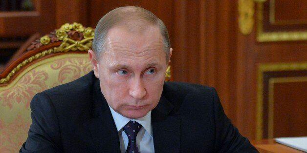 Russian President Vladimir Putin meets with Chuvashia regional leader Mikhail Ignatyev in the Kremlin...