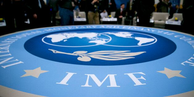 The International Monetary and Financial Committee (IMFC) logo is seen at an IFMC meeting during the...