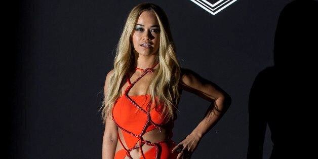 Singer Rita Ora arrives for Atelier Versace's Spring-Summer 2016 Haute Couture fashion collection presented...