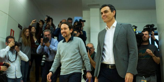 Spain's Socialist Party leader Pedro Sanchez, right, and Podemos Party leader Pablo Iglesias arrive for...