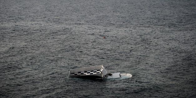 A boat that capsized is seen on January 31, 2016 in Canakkale's Bademli district after at least 37 migrants...