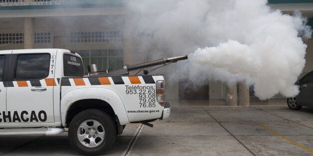 Spraying equipment in the back of a pickup truck from the Chacao municipality is used to fumigate the...