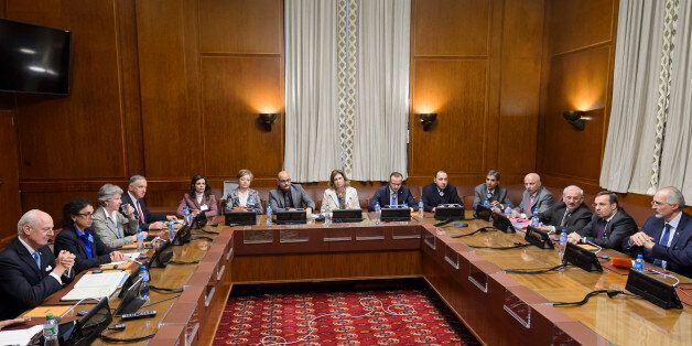 Syrian ambassador to UN and head of the government delegation Bashar al-Jaafari (Far R) faces Syria UN...