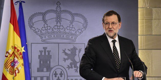 Leader of the ruling Popular Party (PP) and Spanish acting Prime Minister Mariano Rajoy speaks during...