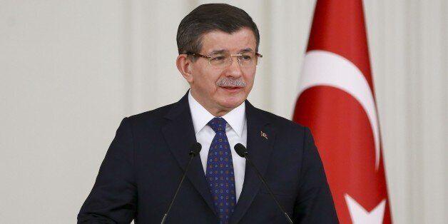 ANKARA, TURKEY - JANUARY 14: Turkish Prime Minister Ahmet Davutoglu delivers a speech during the luncheon...