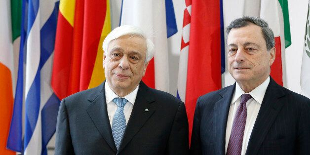 President of Greece Prokopis Pavlopoulos, left, and President of the European Central Bank Mario Draghi,...