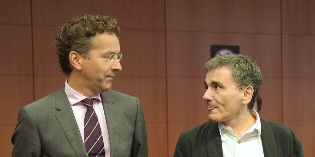 Greece's Finance Minister Euclid Tsakalotos (R) and Eurogroup President and Dutch Finance Minister Jeroen Dijsselbloem talk during an Eurogroup meeting at the EU headquarters in Brussels, on August 14, 2015. Greece's huge debt mountain remains a 'major point of concern' as eurozone finance ministers discuss whether to endorse a third bailout-for-reform deal, Eurogroup head Jeroen Dijsselbloem said. AFP PHOTO / EMMANUEL DUNAND        (Photo credit should read EMMANUEL DUNAND/AFP/Getty Images)
