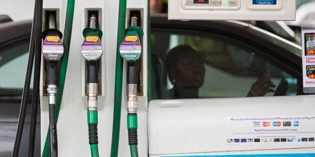 A petrol pump is pictured at a petrol station in south London on January 6, 2015. Oil prices slid Tuesday...