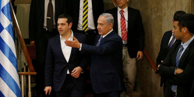 Israel's Prime Minister Benjamin Netanyahu and Greece's Prime Minister Alexis Tsipras, arrive for a press...
