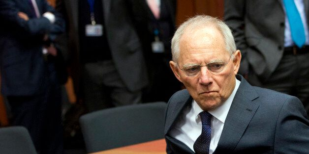 German Finance Minister Wolfgang Schaeuble arrives for a meeting of eurogroup finance ministers at the...