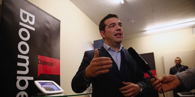 Alexis Tsipras, Greece's prime minister, speaks to reporters inside the Bloomberg Television offices...