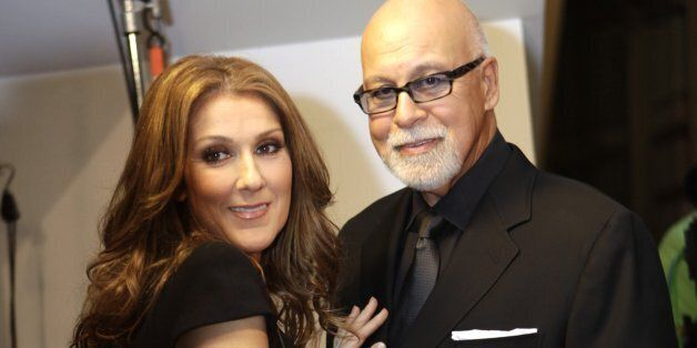 Celine Dion, left, talks with her husband Rene Angelil, right, before walking on the red carpet for the...