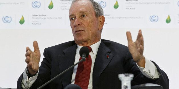 Former New York City Mayor Michael Bloomberg, right, gestures as he speaks during a panel discussion