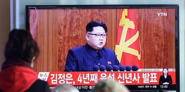 South Koreans watch a TV news program showing North Korean leader Kim Jong Un's New Year speech, at the...