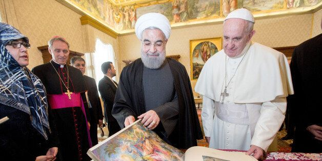 VATICAN CITY, VATICAN - JANUARY 26: Pope Francis exchanges gifts with President of Iran Hassan Rouhani...