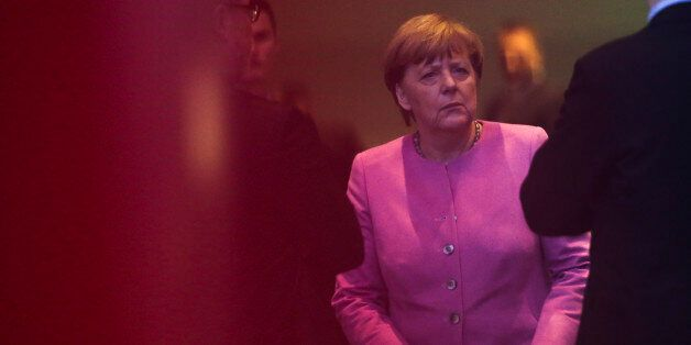 German Chancellor Angela Merkel is surround by staff of the chancellery as she waits for the arrival...