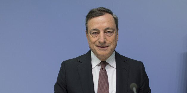 Mario Draghi, president of the European Central Bank (ECB), speaks during a news conference to announce...