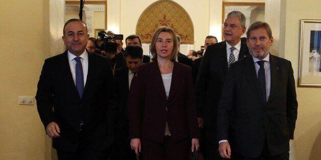 ANKARA, TURKEY - JANUARY 25: Turkish Foreign Minister Mevlut Cavusoglu (L), Turkey's EU Minister Volkan...