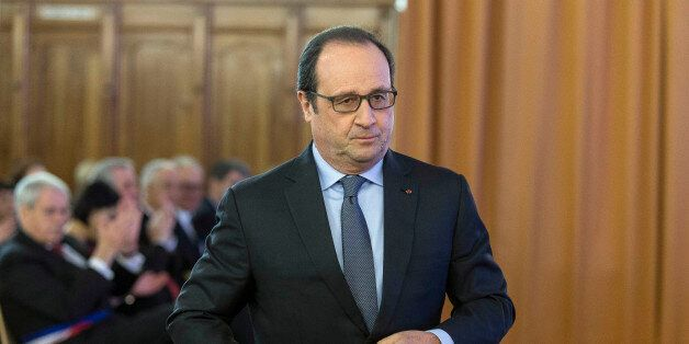 French President Francois Hollande prepares to deliver his speech during the inauguration of the Unterlinden...