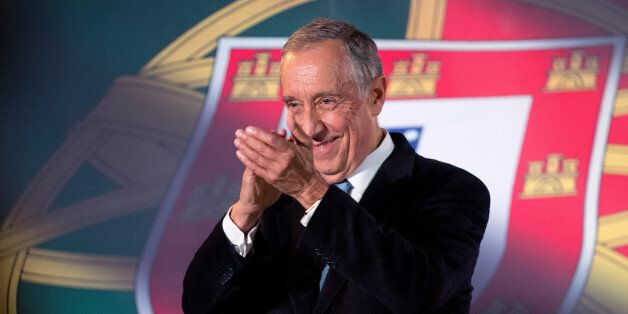 Marcelo Rebelo de Sousa applauds after addressing supporters at Lisbon's Santa Apolonia train station...