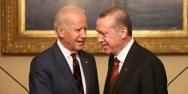 U.S. Vice President Joe Biden, left, and Turkish President Recep Tayyip Erdogan shake hands after a joint...