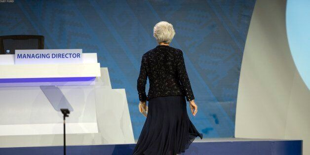 International Monetary Fund Chief Christine Lagarde returns to her seat after delivering a speech at...