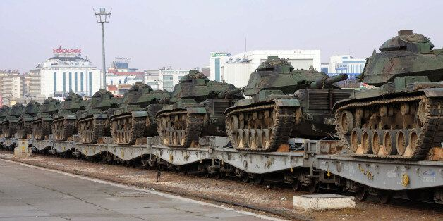 Turkish army tanks are stationed at a train station after their arrival from western Turkey, in Gaziantep,...