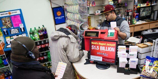 WASHINGTON, USA - JANUARY 13: A customers buy multiple Powerball tickets for the record $1.5 billion...