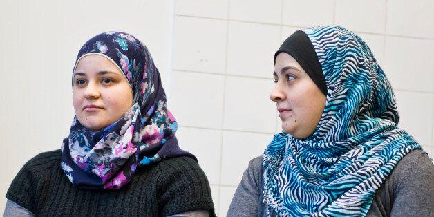 BERLIN, GERMANY - JANUARY 07: Migrants from Syria who work as Volunteers of Federal Volunteer-Service,...