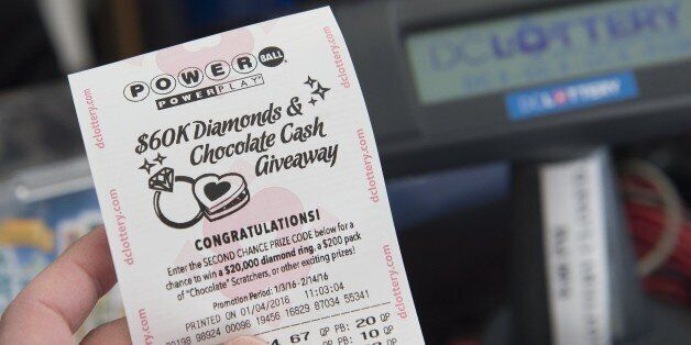 A Powerball lottery ticket is seen at a liquor store in Washington, DC, January 4, 2016. Lottery officials...