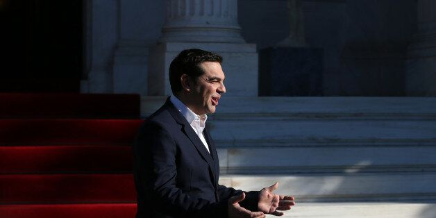 Greek Prime Minister Alexis Tsipras, gestures during the arrival of the Palestinian President Mahmoud...