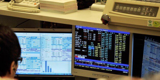 A trader works at the Hong Kong Stock Echange in Hong Kong on August 8, 2011. Hong Kong shares dived...