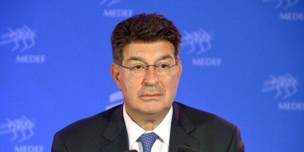Greece's Employers' association SEV President Theodoros Fessas attends a press conference at the French...